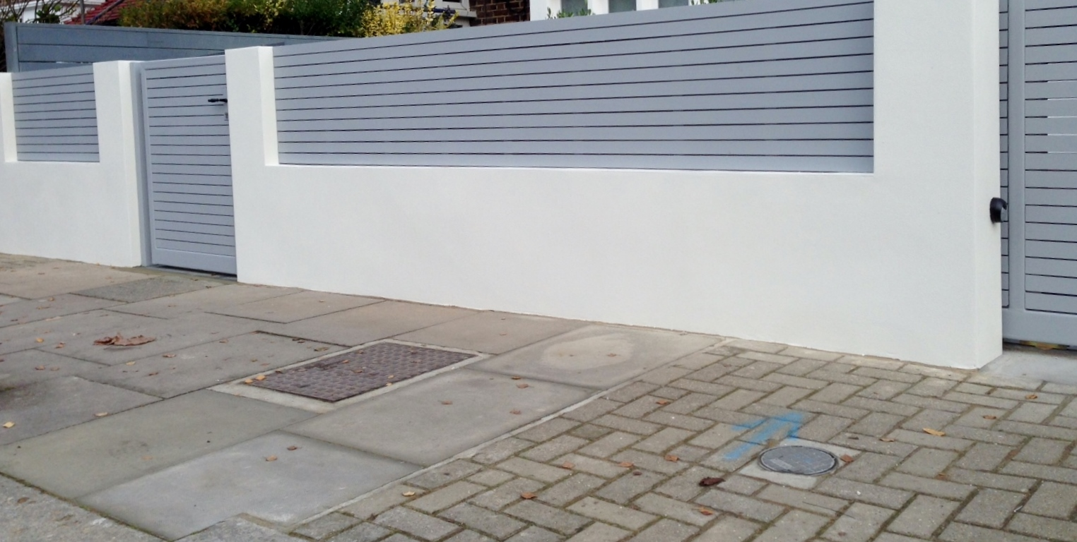 front boundary wall screen automated electronic gate installation grey wooden fence bike store modern garden design balham clapham london (9)