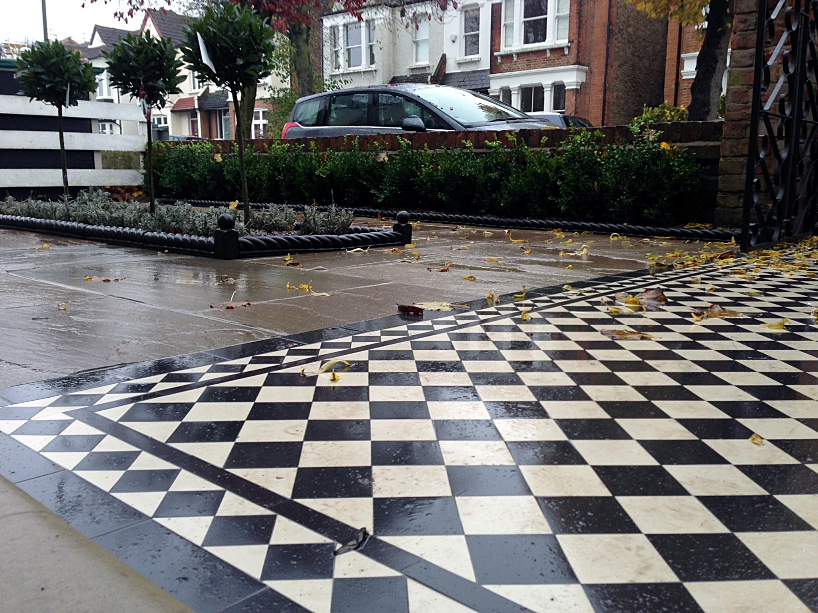 victroian black and white mosaic tile garden path paving formal planting buxus bay lavender edge tiles london (4)