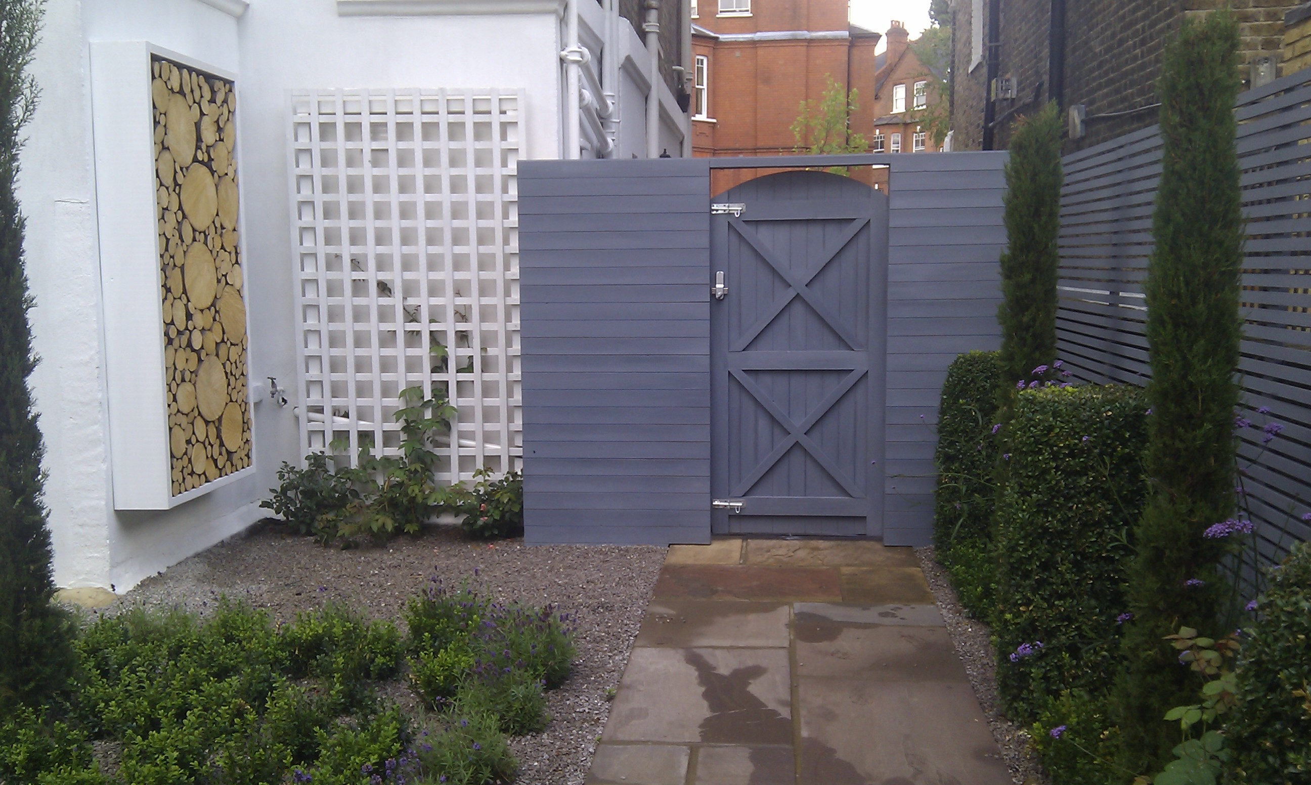 artificial easy grass paving cedar screen planting garden design belsize park hampstead london (2)