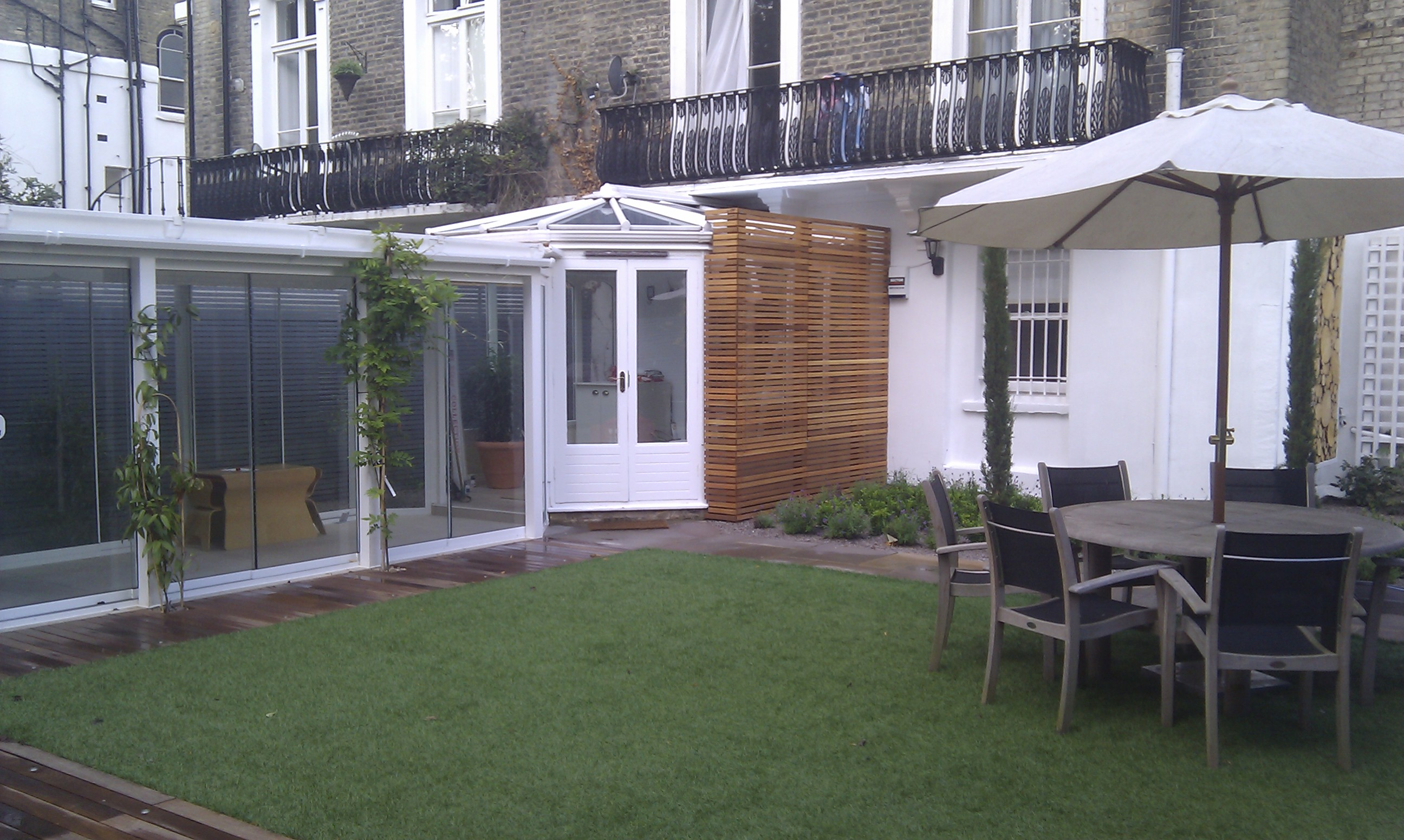 artificial easy grass paving cedar screen planting garden design belsize park hampstead london (4)
