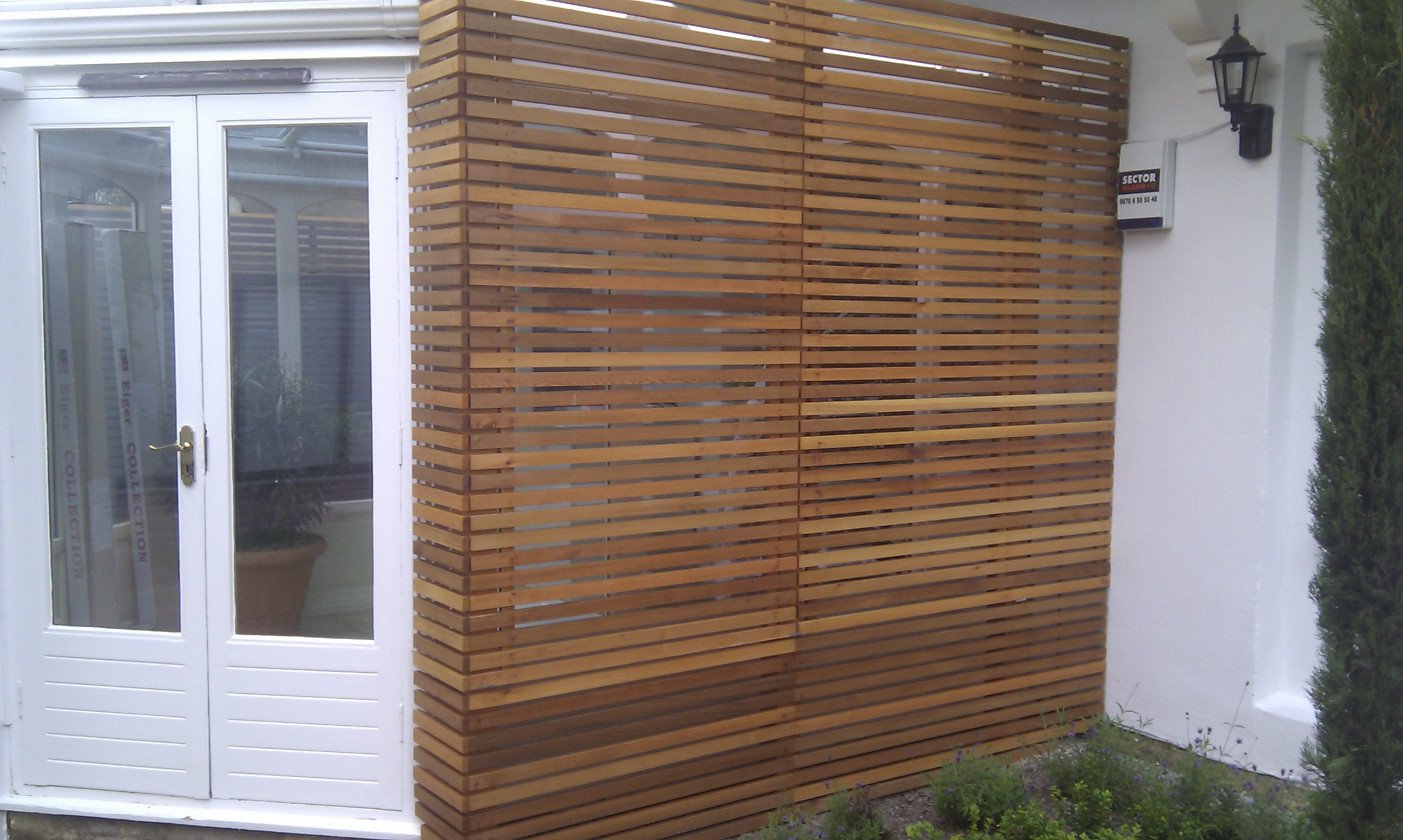 modern planting easy grass grey trellis screen sandstone paving designer design garden hampstead belsize park london (10)