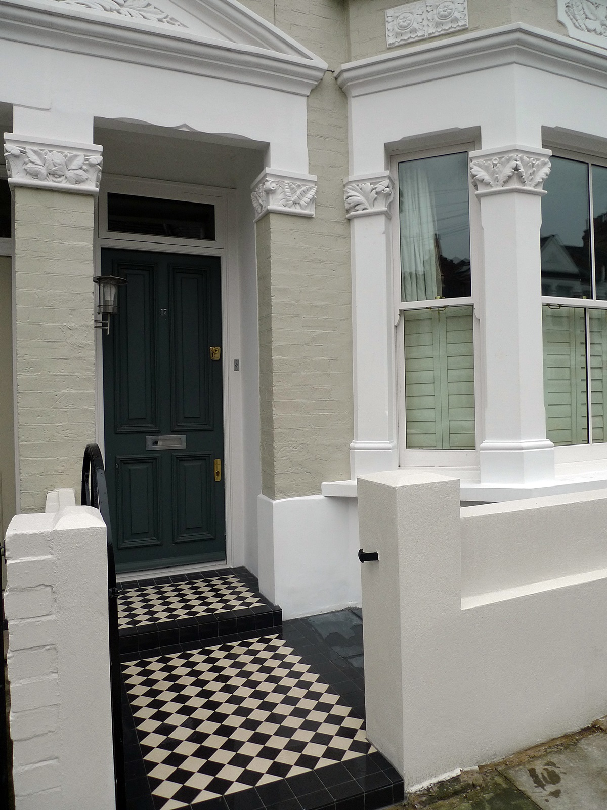 front garden fulham and chelsea london rendered wall slate tiles and black and white victroian mosaic tile path