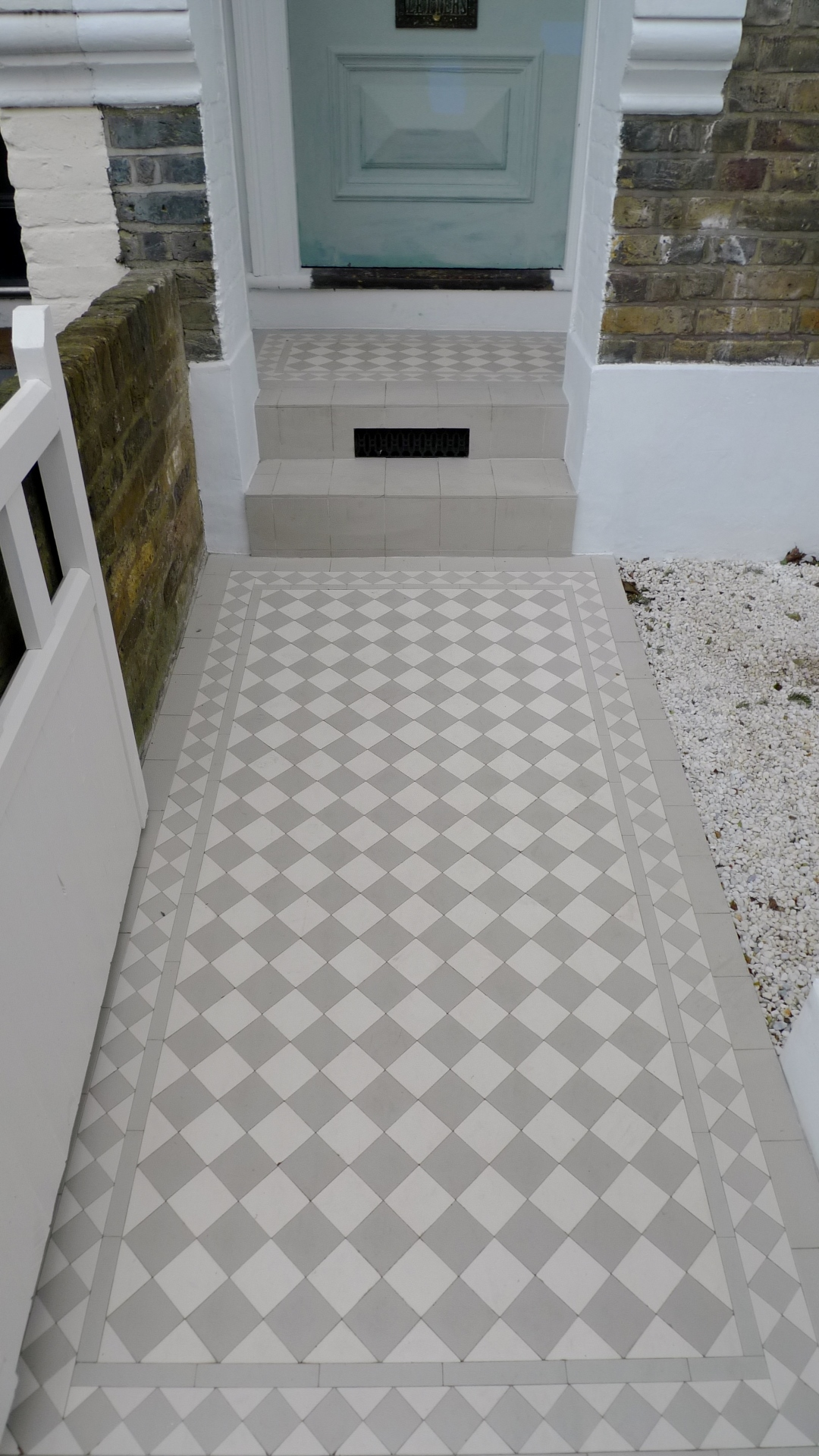 grey and white mosaic path