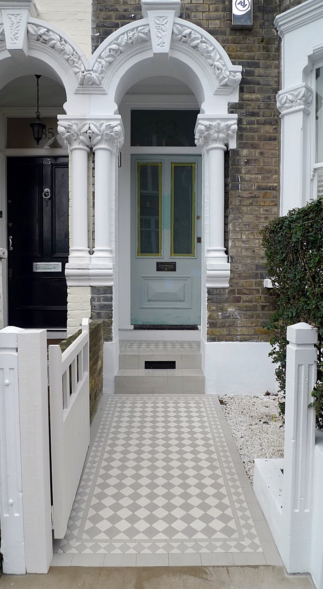 grey and white victorian mosaic tile path