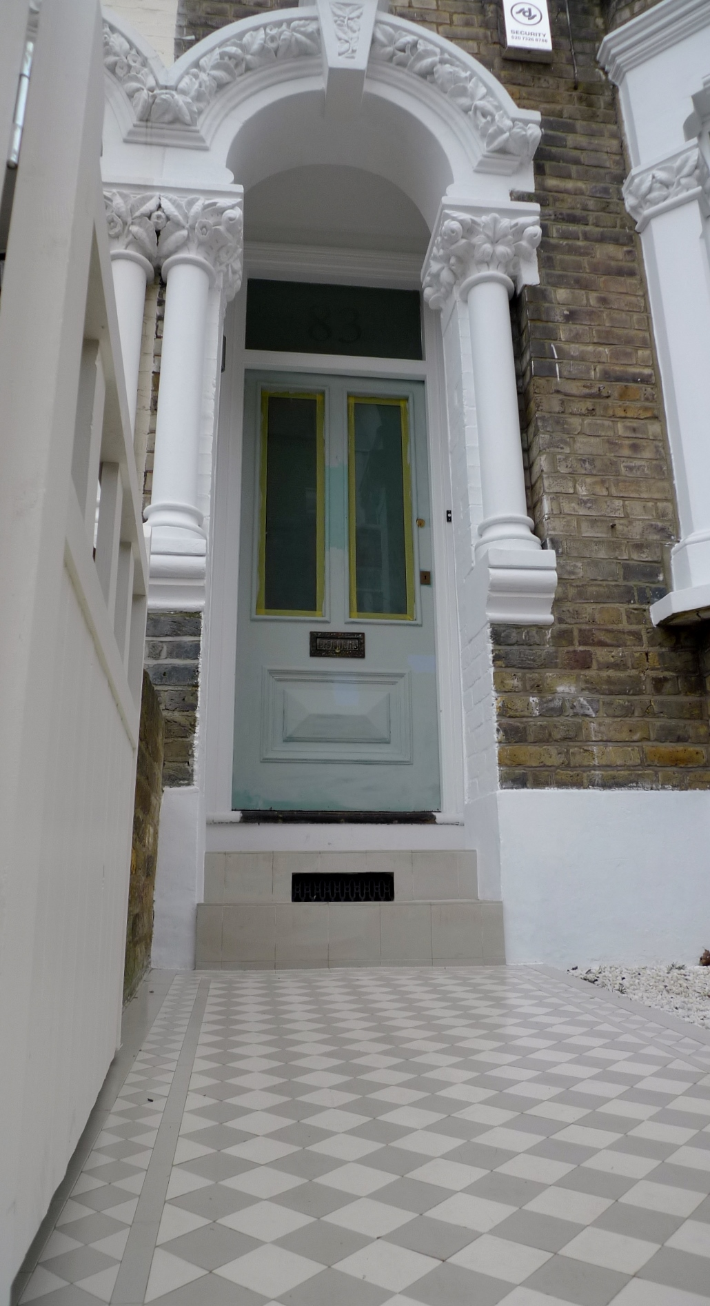 london front garden design grey and white mosaic tile path clapham london