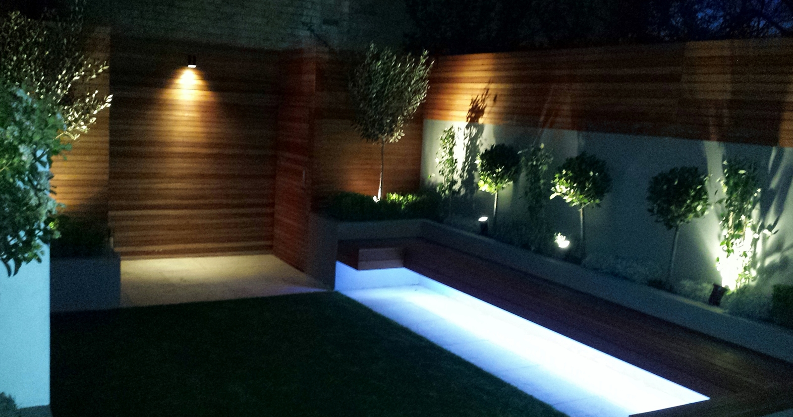 Modern garden design ideas great lighting fireplace hardwood screen plastered rendered walls clapham battersea  south west london LED strip lights formal low maintenance planting