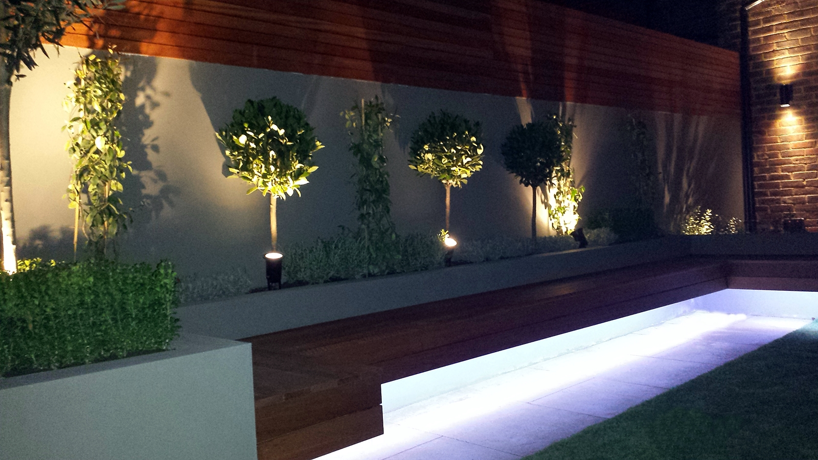 Modern garden design ideas great lighting fireplace hardwood screen plastered rendered walls clapham battersea  south west london LED strip lights landscaping
