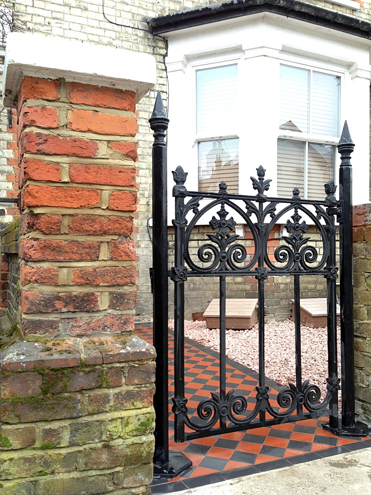 cast iron gate brick wall black and red victroian mosaic surbition kingston wimbledon london
