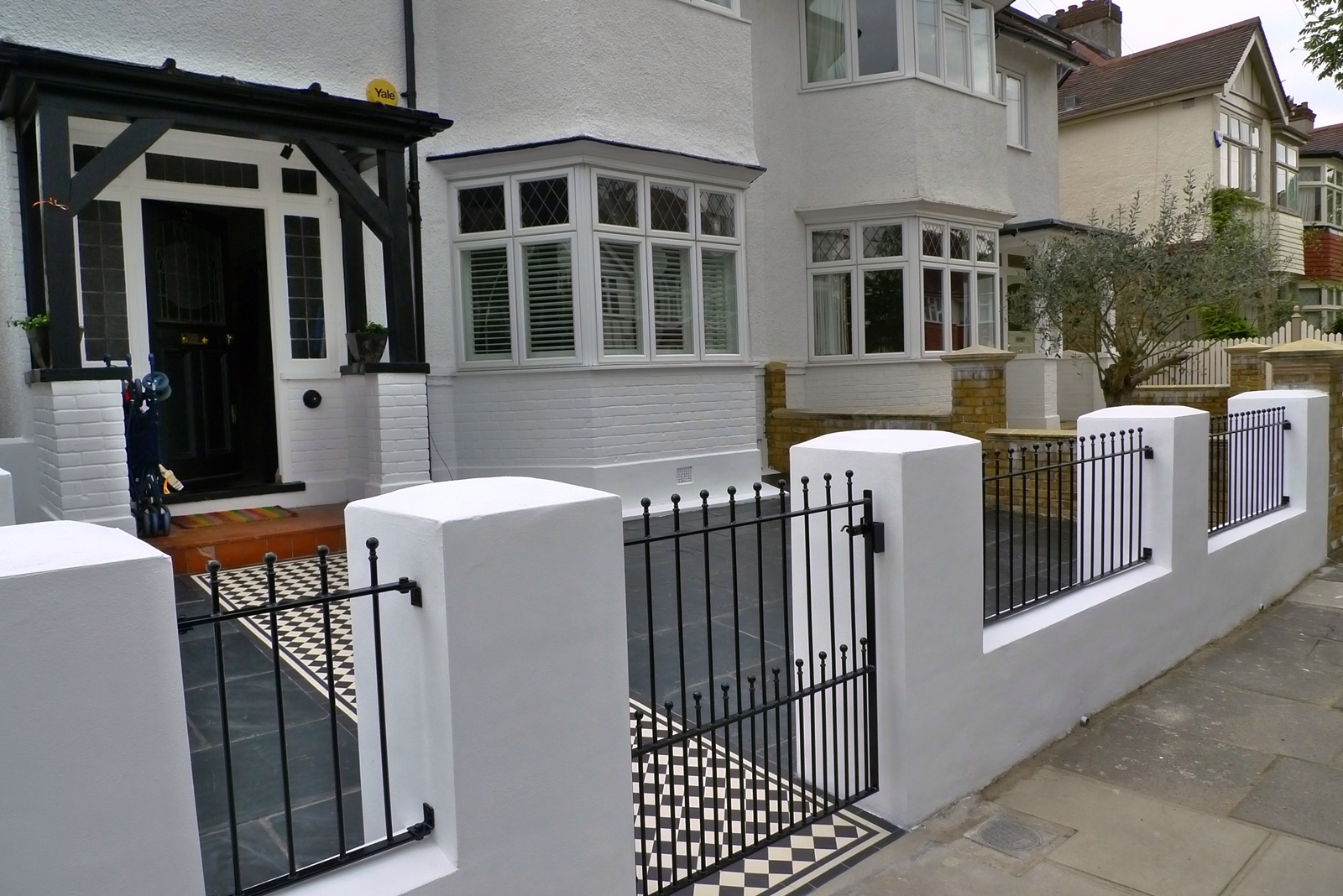 front garden wall metal rail and gate slate paving front garden design shenn richmond west london