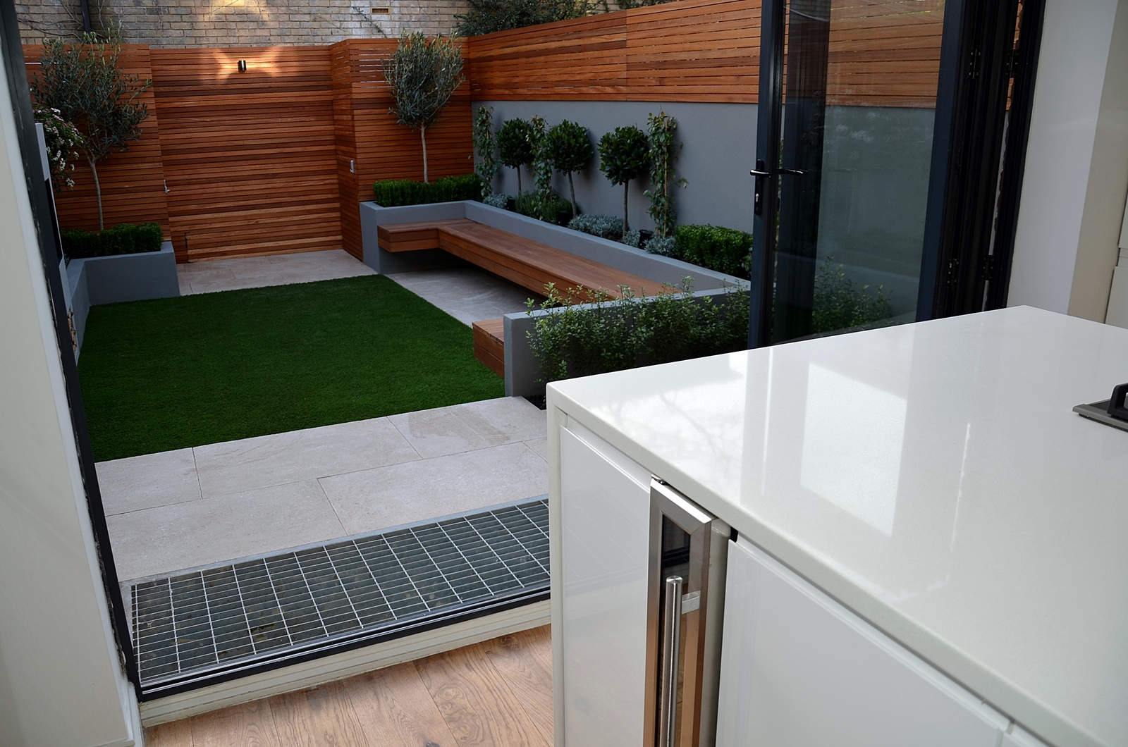 limestone paving floating hardwood bench cedar screen low maintenance ultra chic modern garden design battersea clapham london