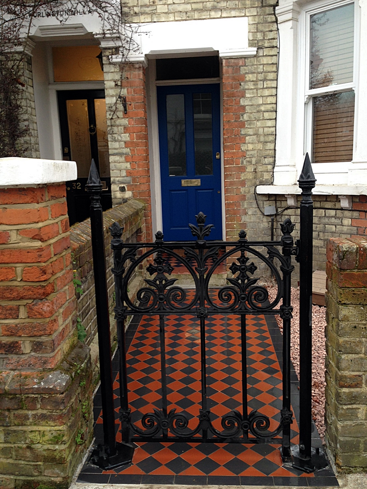 metal gate old stock brick yellow and red wall mosaic tile path london