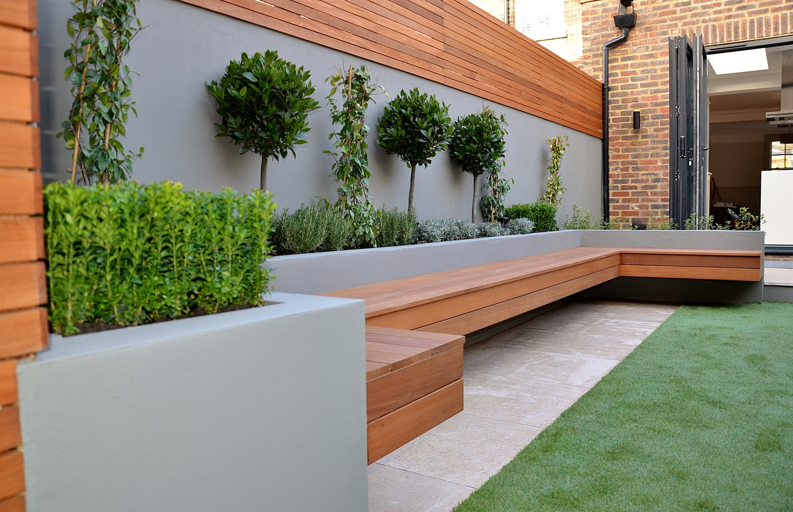 Modern garden design ideas great lighting fireplace hardwood screen plastered rendered walls - Garden ideas london ...