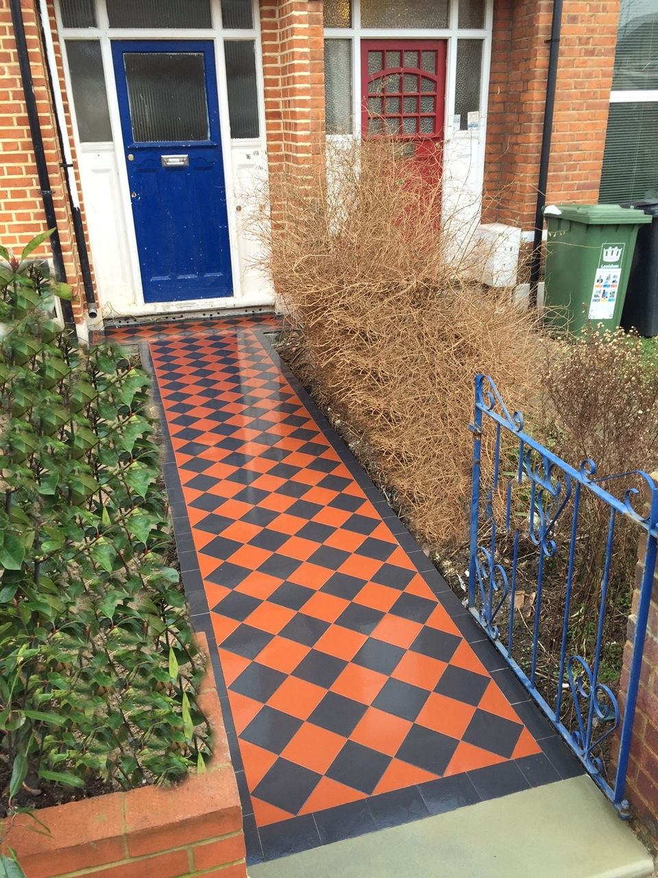 victorian black and red mosaic tile path london