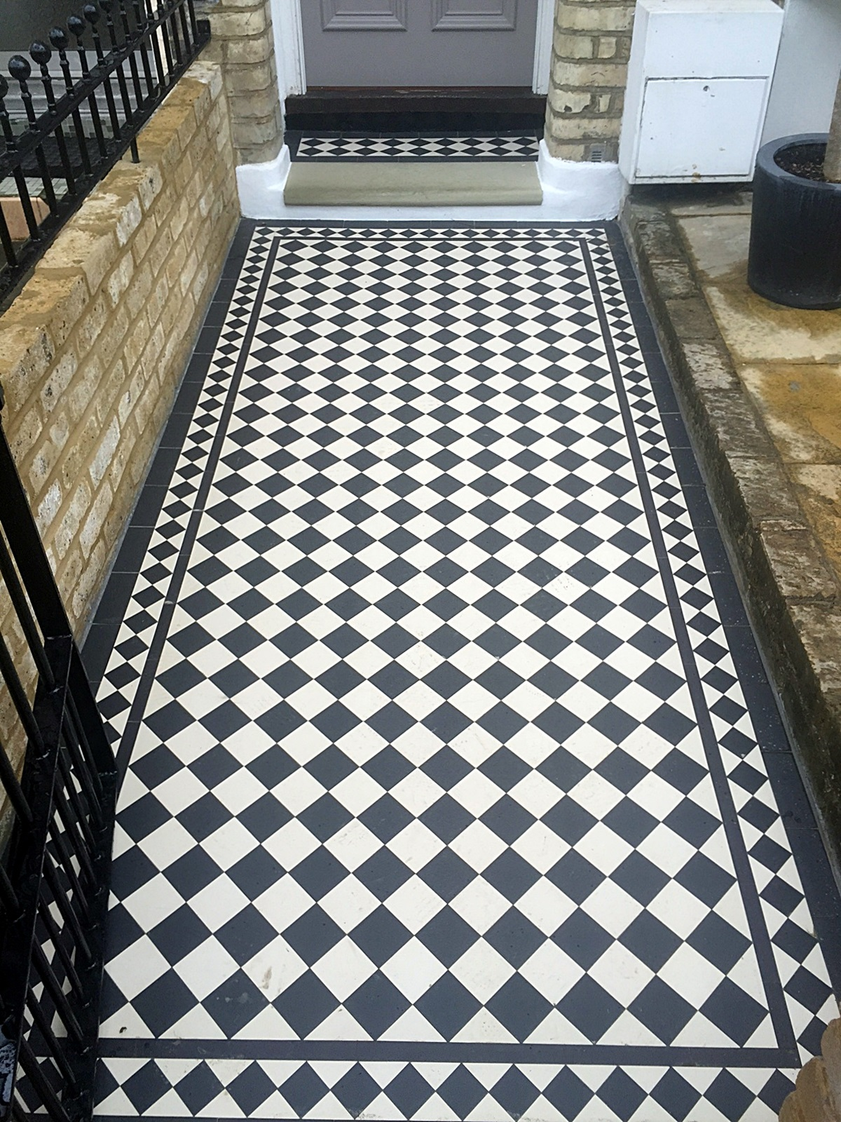 black and white victroain mosaic tile path london