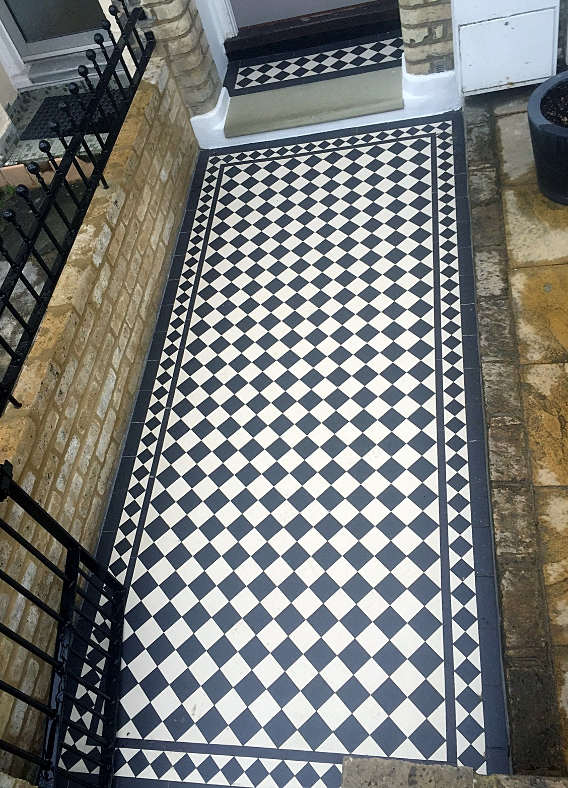black and white victroian mosaic tile path with new yellow brick garden wall peckham east dulwich herne hill london