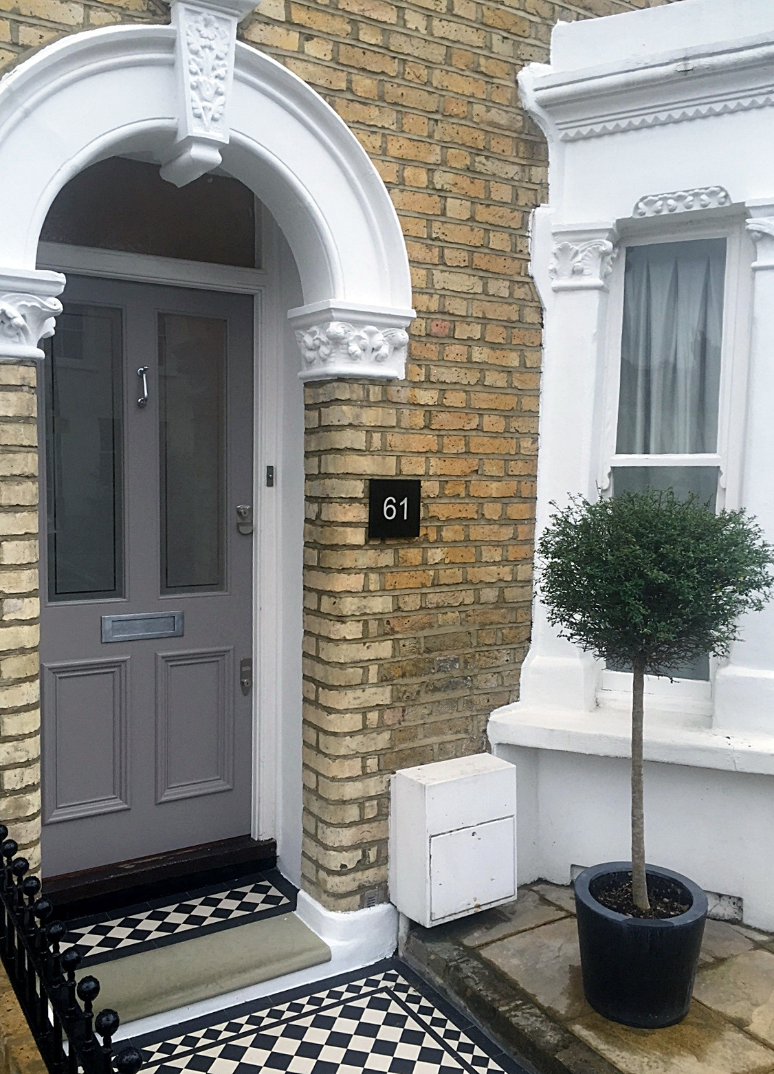 front door and porch victorian style east dulwich mosaic topiary york stone peckham london