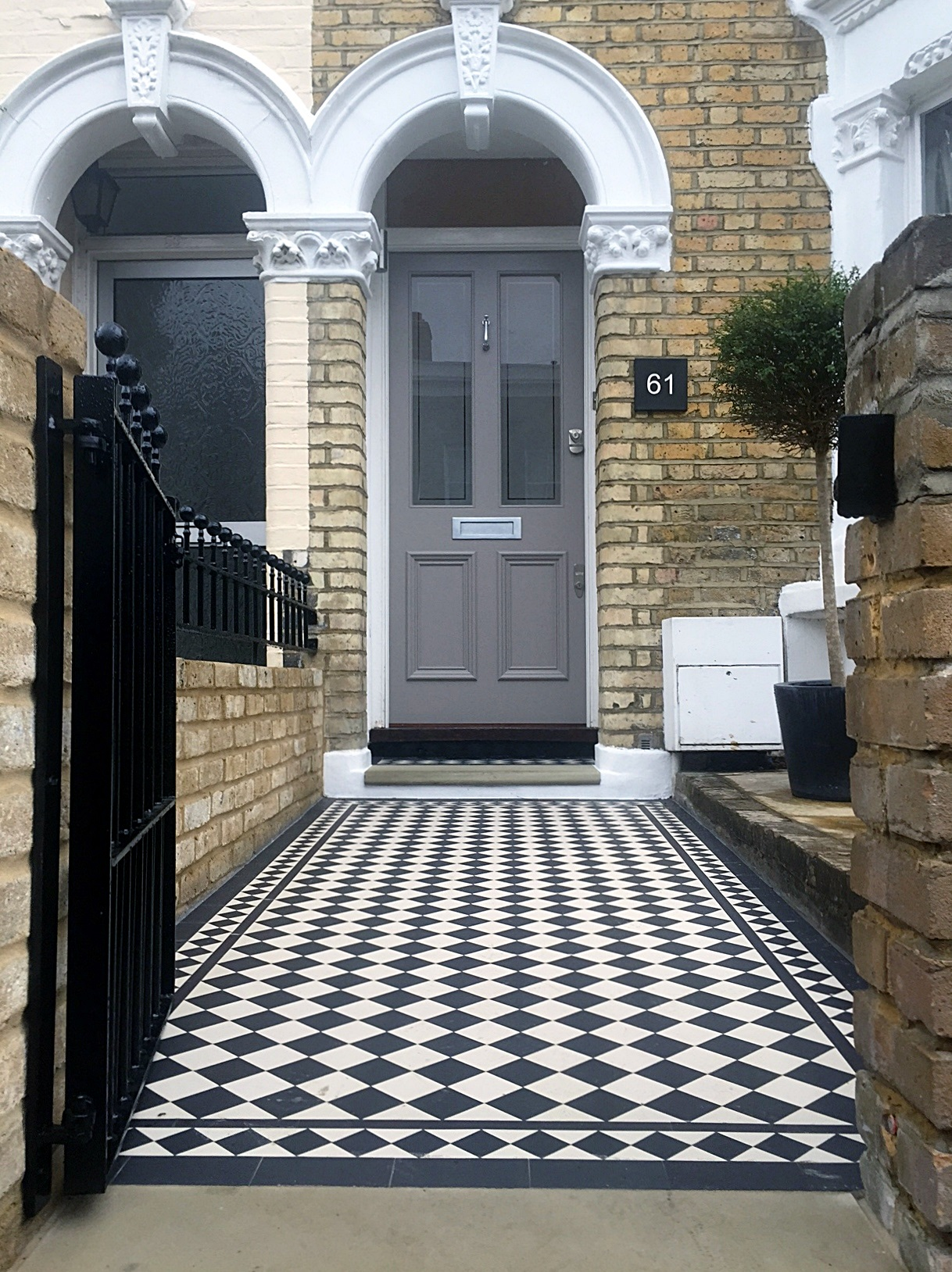 London front door with victorian black and white mosaic for Home front tiles design