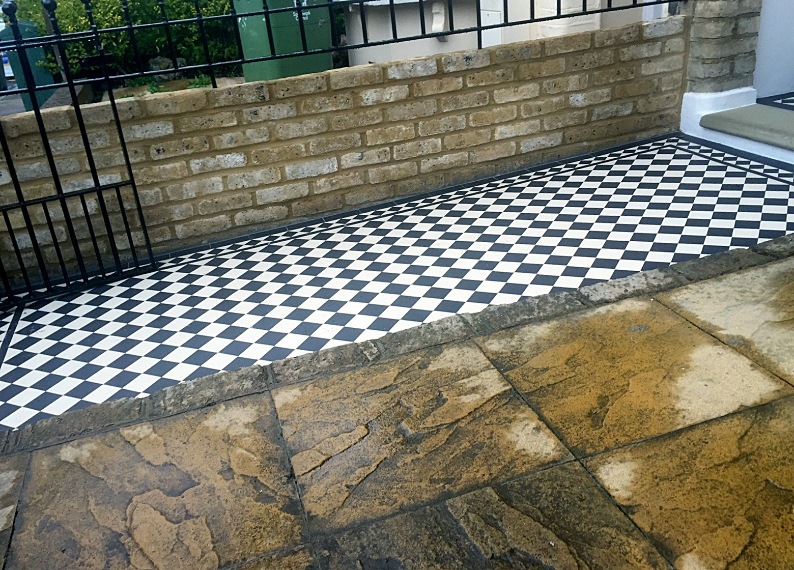 side profile view balck and white victorian mosaic tile path dulwich peckham herne hill london