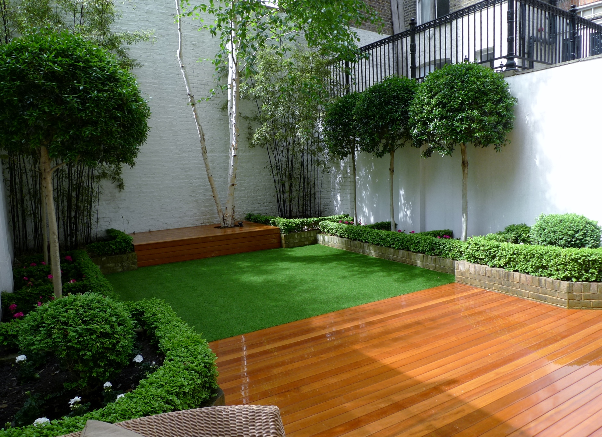 balau hardwood decking  fake grass mature topiary planting battersea fulham chelsea london