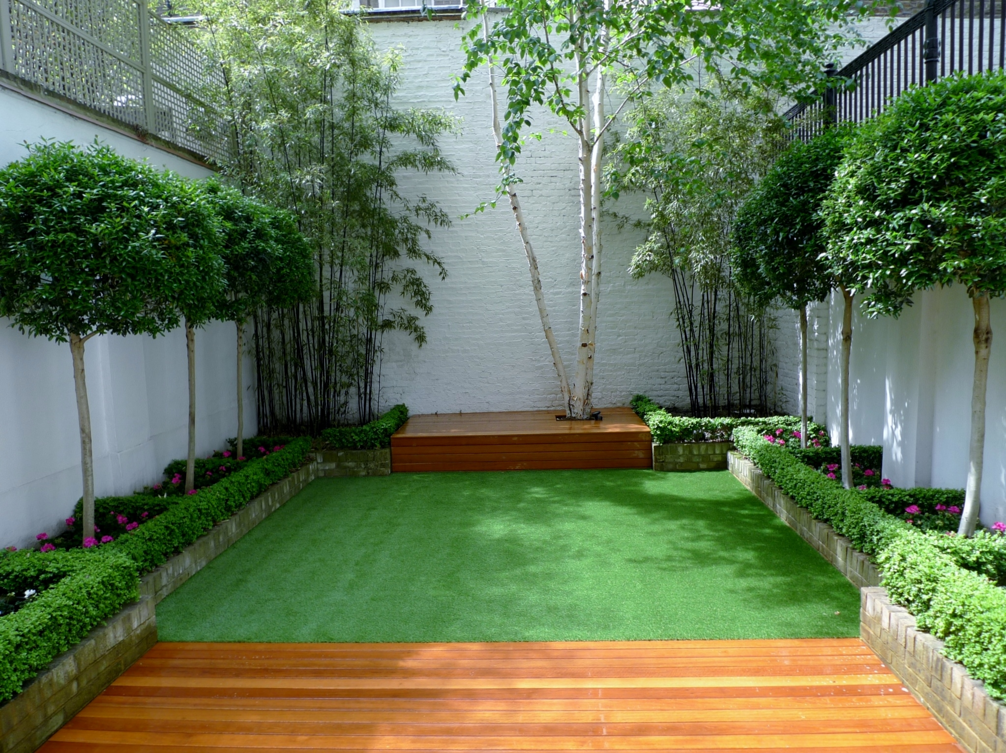 Modern garden design chelsea fulham battersea deck grass for Modern garden design