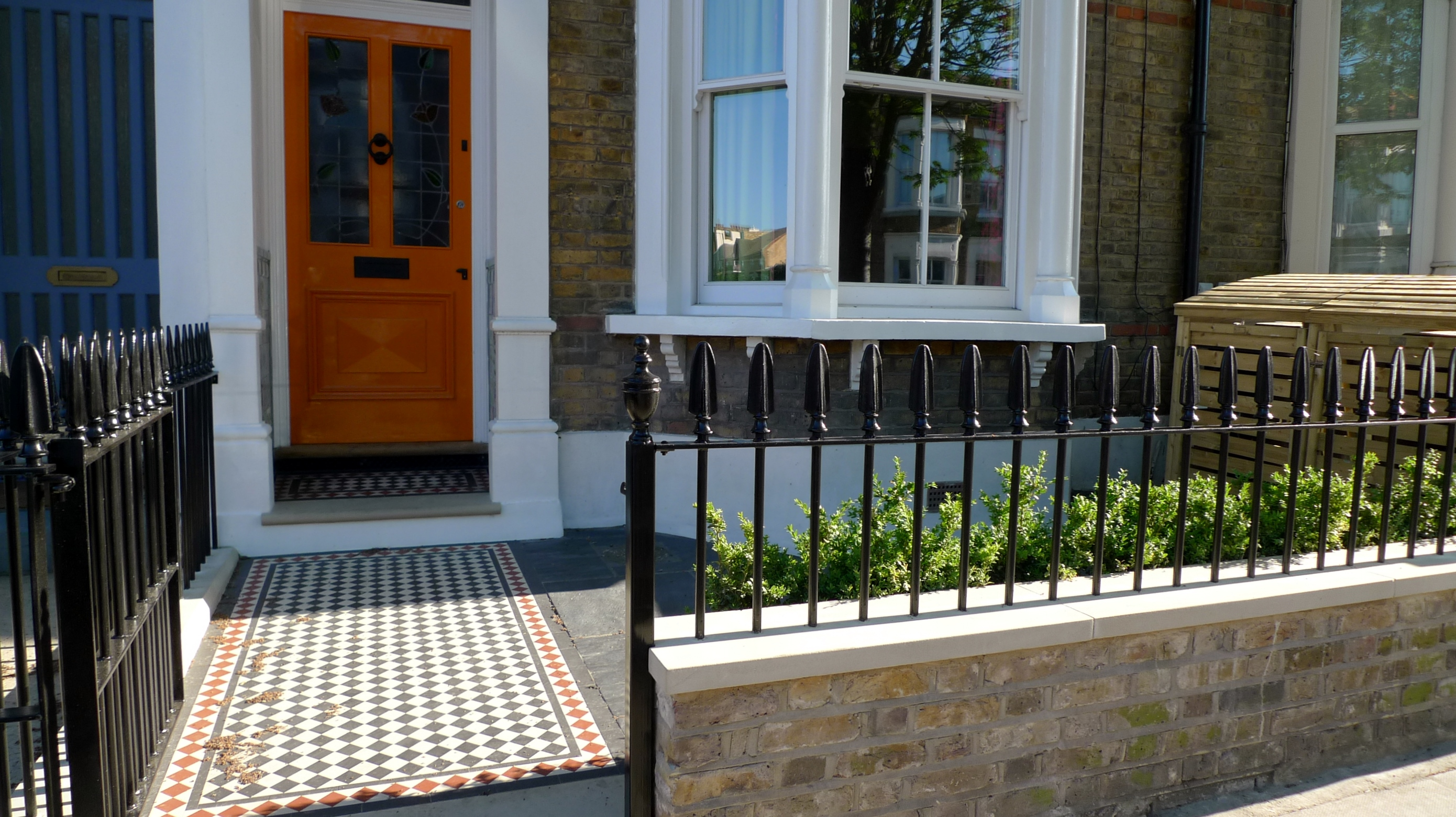 brick wall heavy drilled metal wrough rail and gate yorkstone plinth victorian mosaic tile path slate paving bullnose yorkstone peckham dulwich clapham battersea
