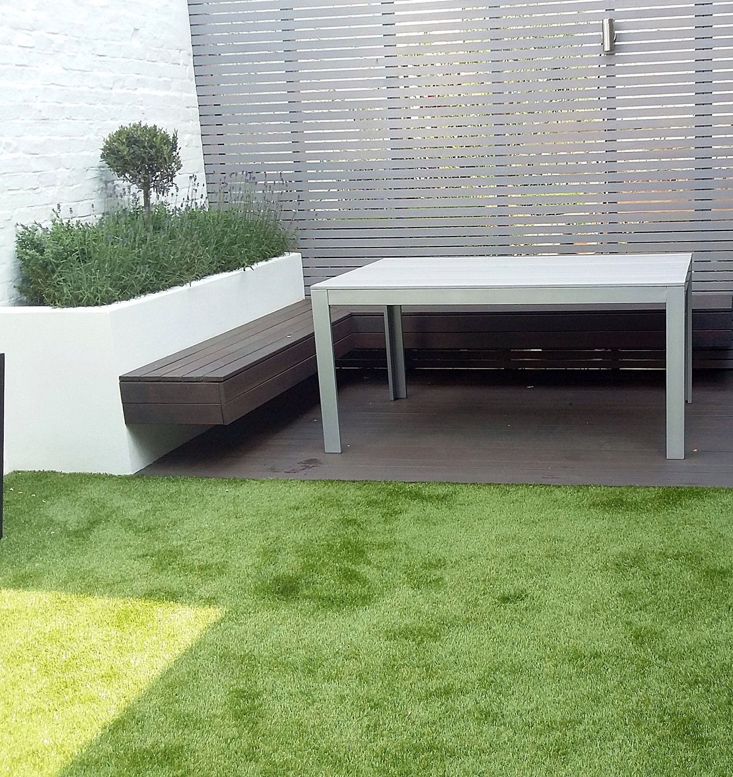 low maintenance modern small garden design putney london screen grey hardwood bench raised bed artificial grass
