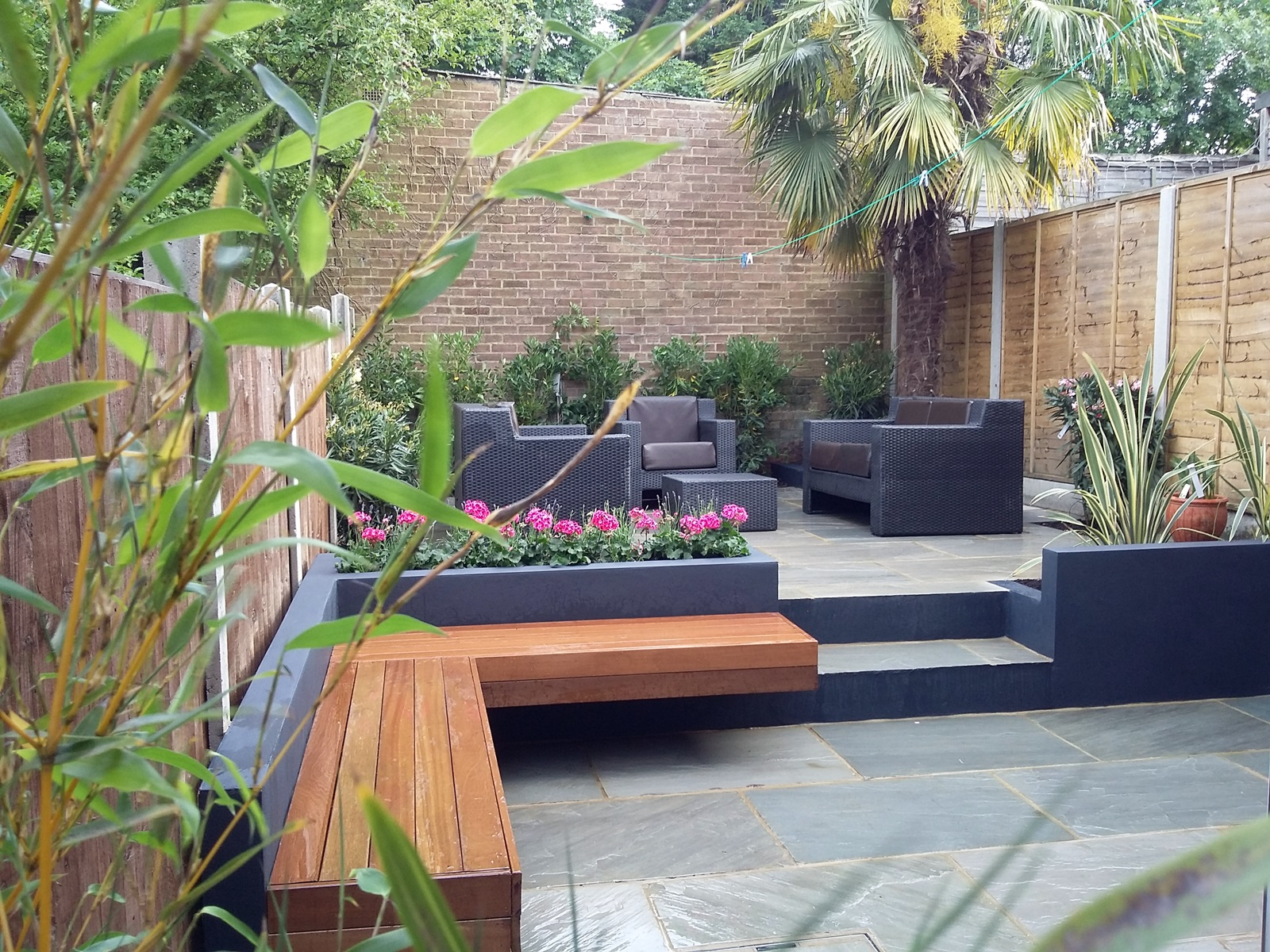 modern garden design london natural sandstone paving patio design hardwood floating bench grey blcok render brick raised beds architectural planting balham chelsea fulham battersea clapham