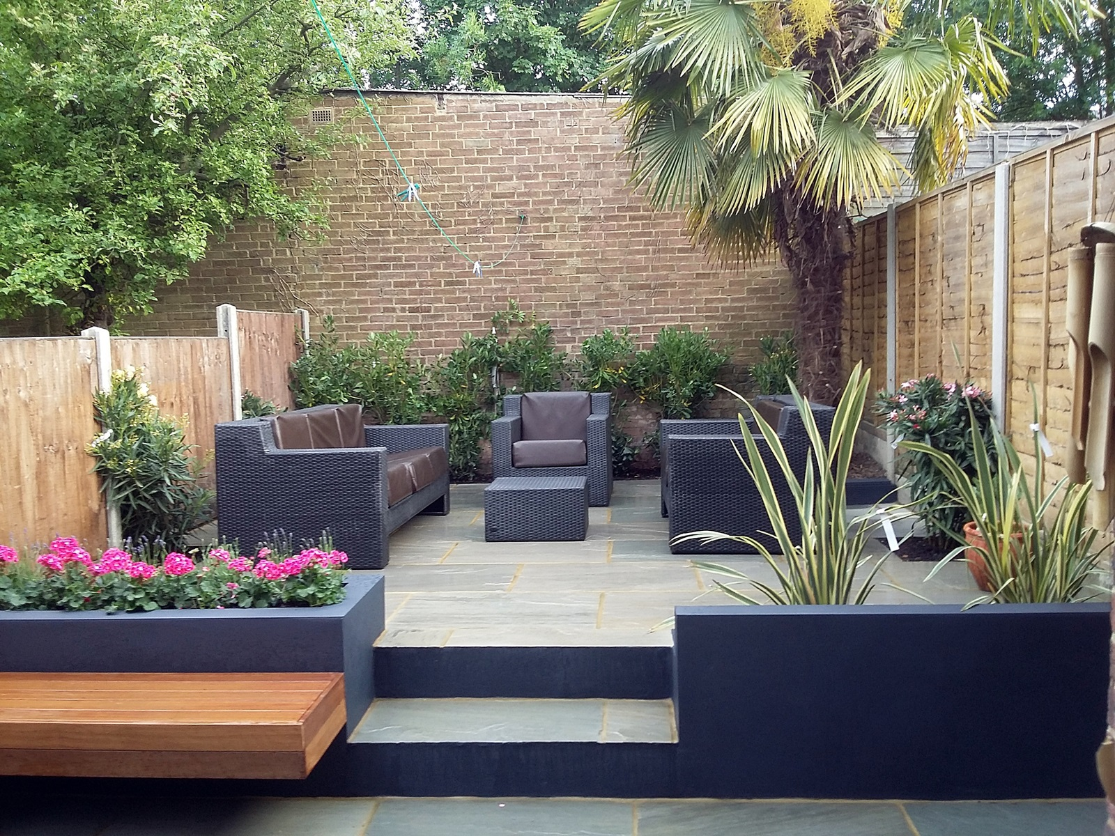 modern low maintenance small london garden paving raised concrete block render walls hardwood bench clapham dulwich balham battersea london design