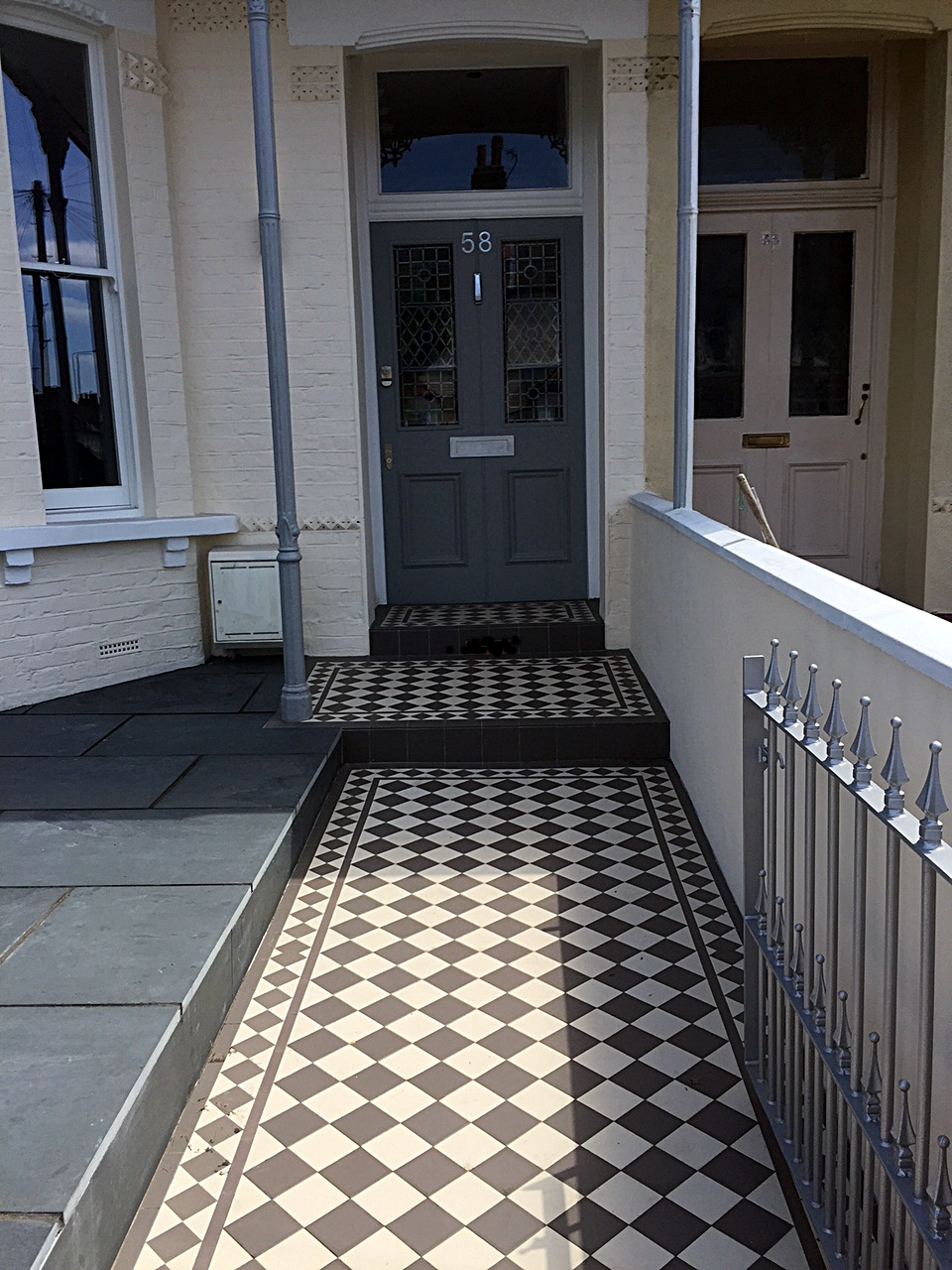 grey and white victorian front garden company mosaic tile path