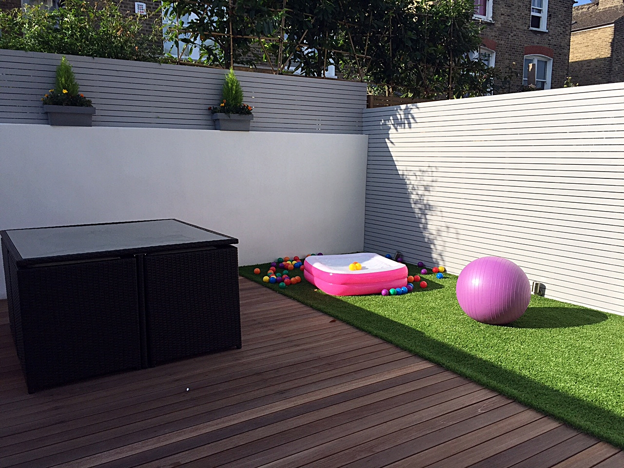 Low maintenance garden design hardwood deck artificial for Garden decking and grass