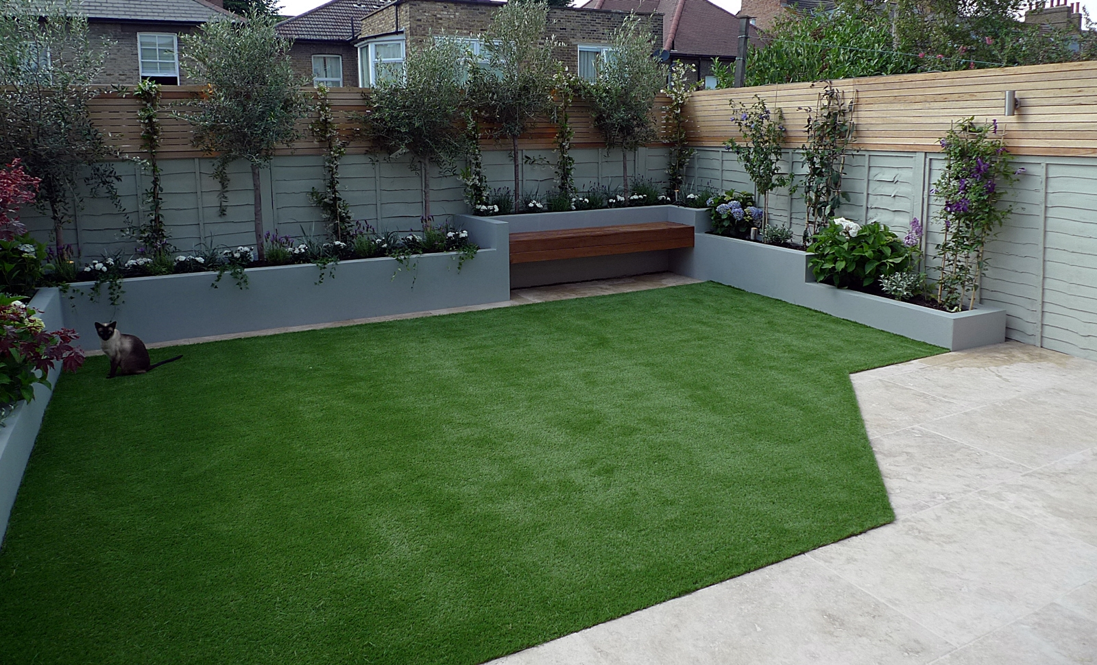 small garden design raised beds artificial grass travertine paving grey block render raised beds painted fence hardwood privacy screen balham clapham dulwich battersea fulahm chelsea