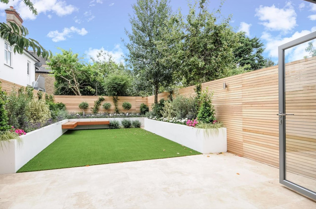 modern garden design london artificial grass travertine paving