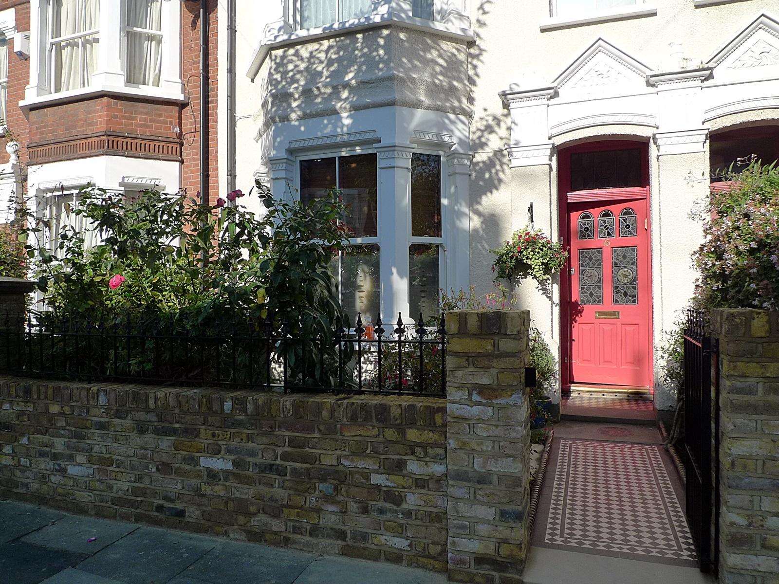 london front garden company victorian black and white mosaic tile path with york stone yellow imperial second hand brick wall with metal rail and gate balham clapham battersea dulwich