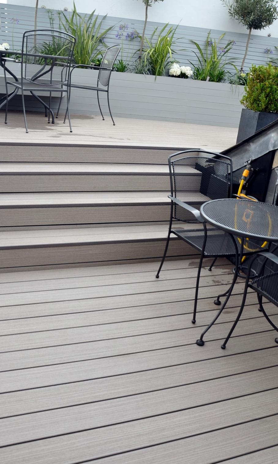 modern garden design docklands penthouse balcony decking planting floating bench composite grey materials london