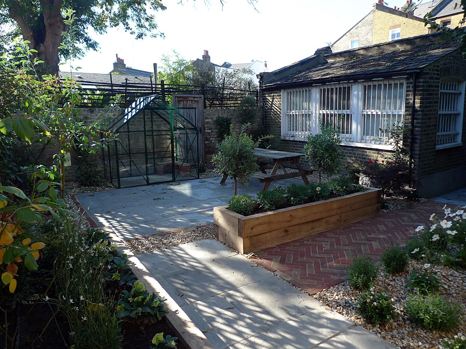 victorian style garden clapham old town garden design oak sleepers herring bone brick path sandstone paving london dulwich battersea