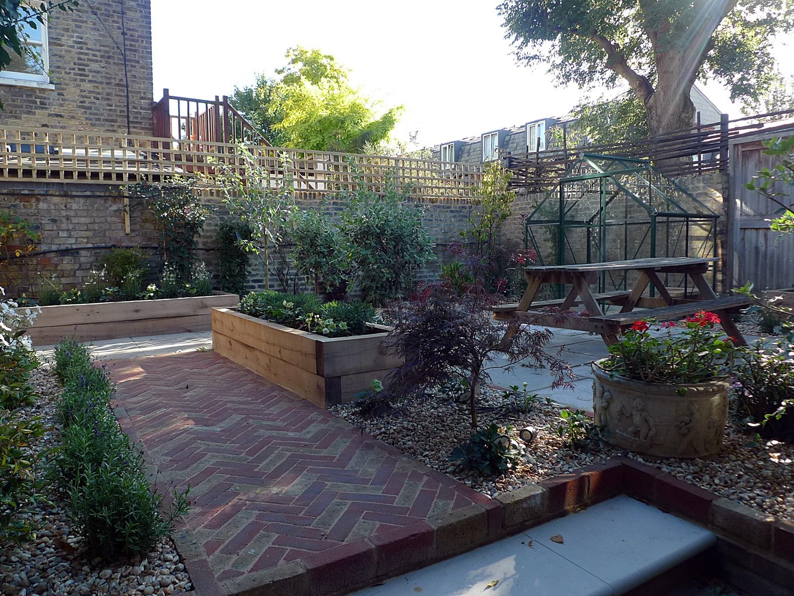 victorian style garden design london herring bone paving sandstone paving oak railway sleeper railway beds