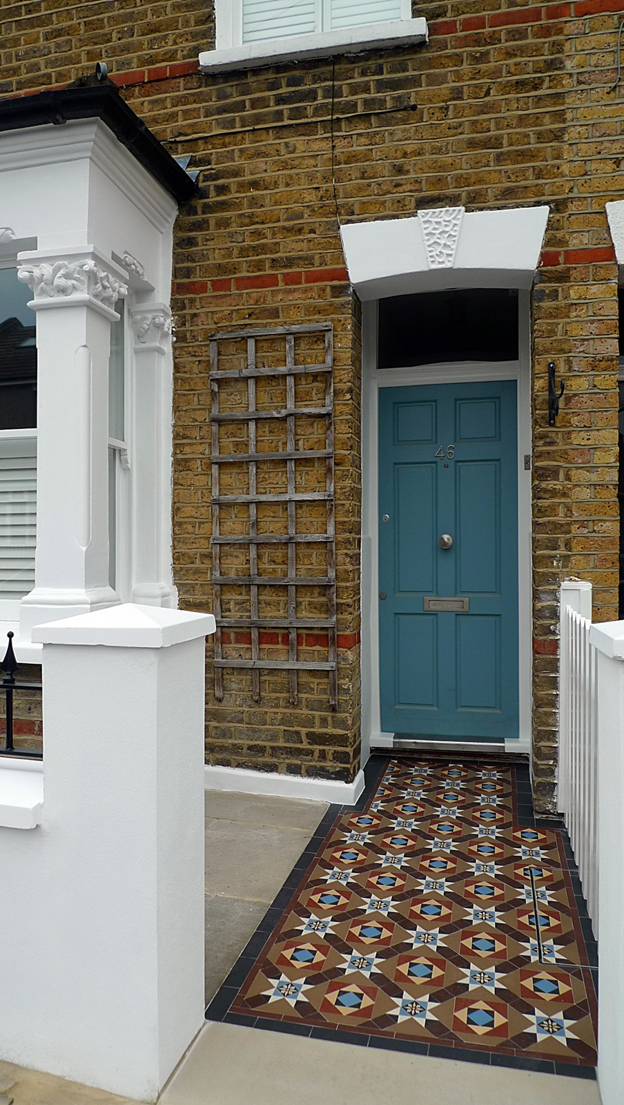 render block white wall yorkstone entrance stone colourful victorian mosaic tile garden path wandsworth earlsfield balham clapham battersea london