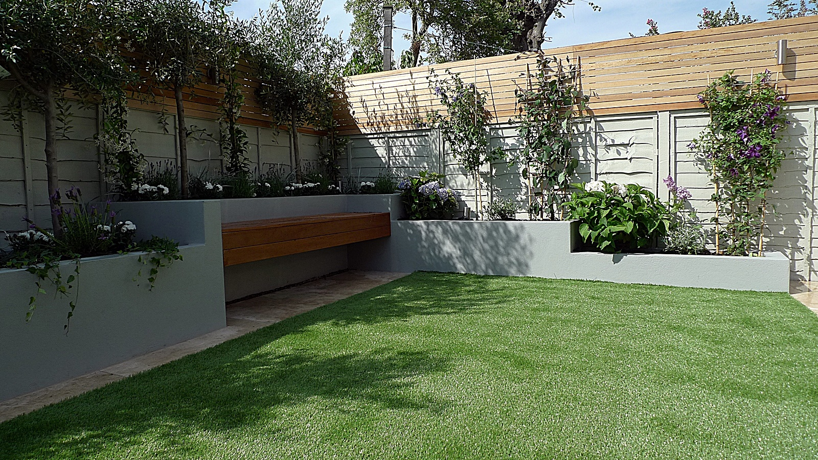 Articicial grass trellis hardwood painted fence  Dulwich Peckham Clapham Balham garden design