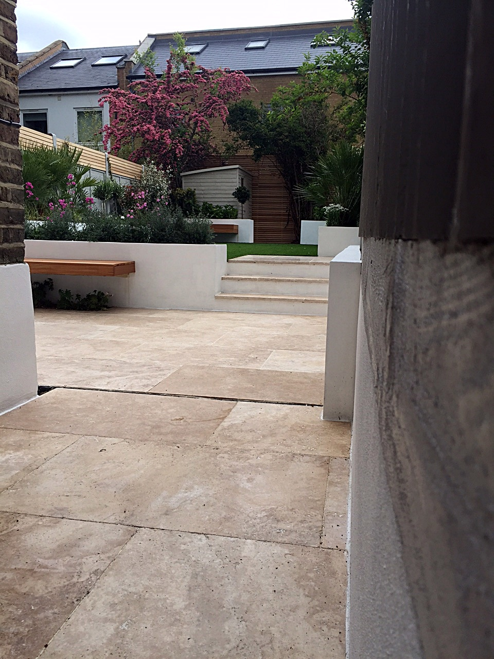 Garden company raised beds planting travertine paving London
