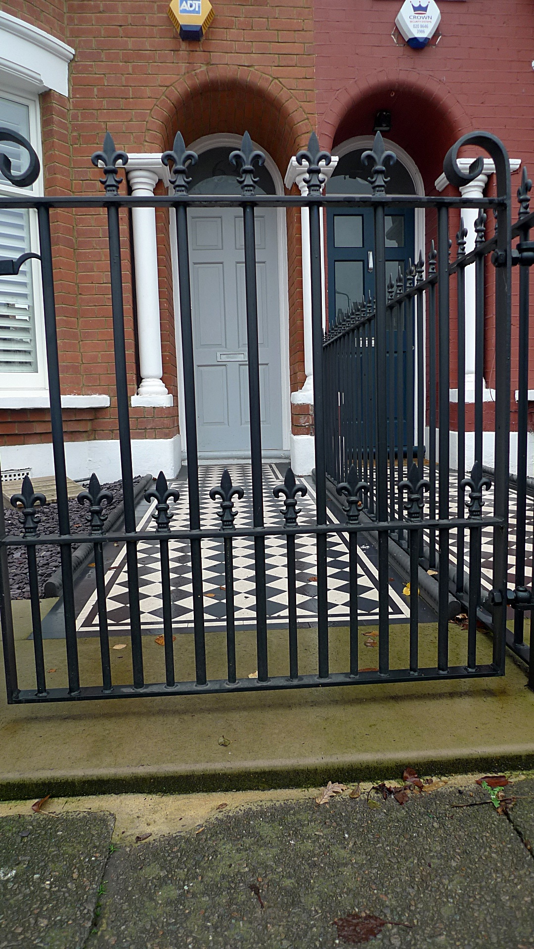 Ornamental stone Victorian mosaic black and white York stone entrance stone metal gate metal rail charcoal rope edge tiles brick garden wall render garden wall Balham Streatham Clapham Battersea London