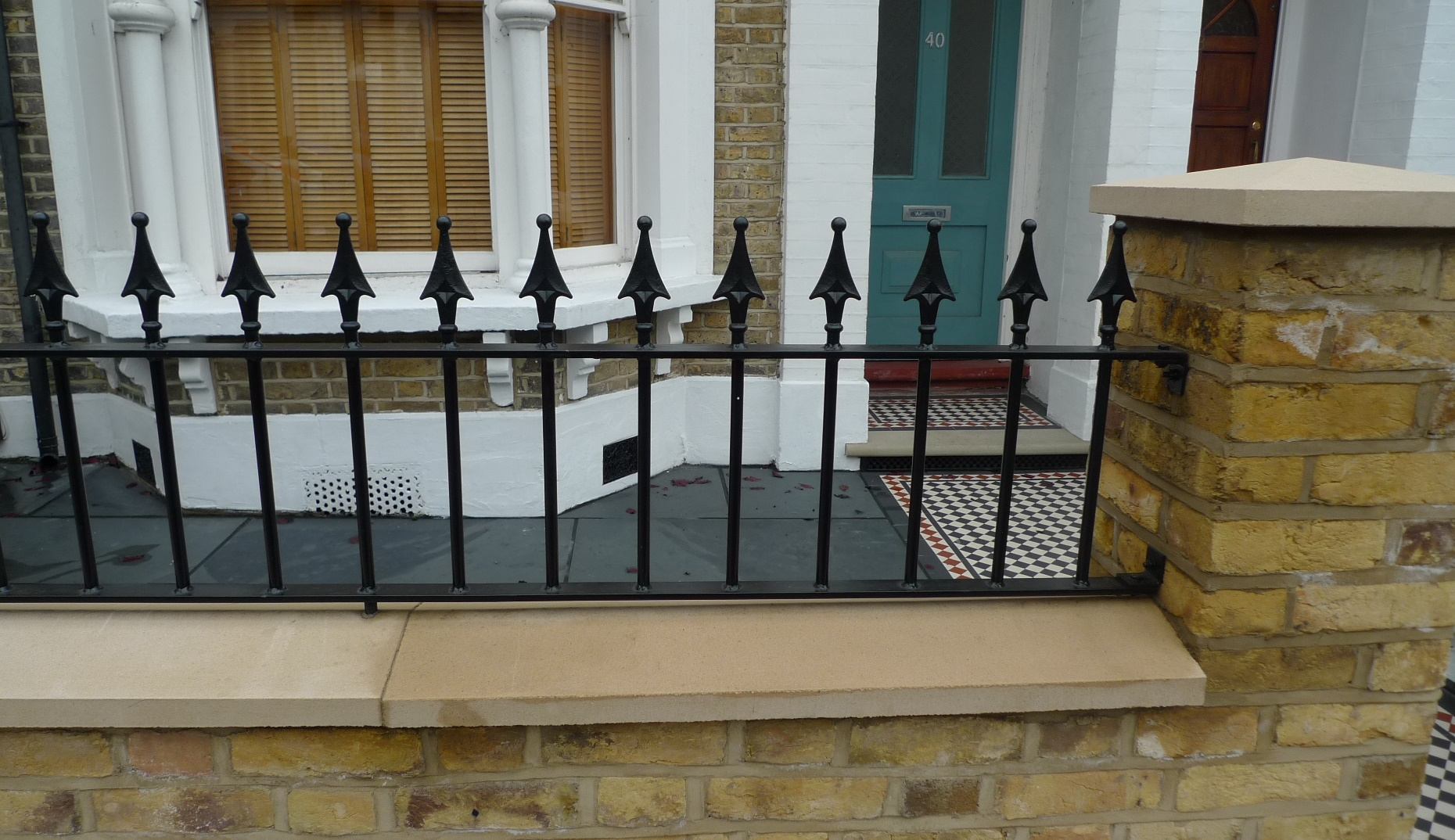 Ornamental stone Victorian mosaic multi colour mosaic metal rail metal gate York stone entrance stone yellow brick render garden wall London stock Earsfield Wandsworth Wimbledon Putney London