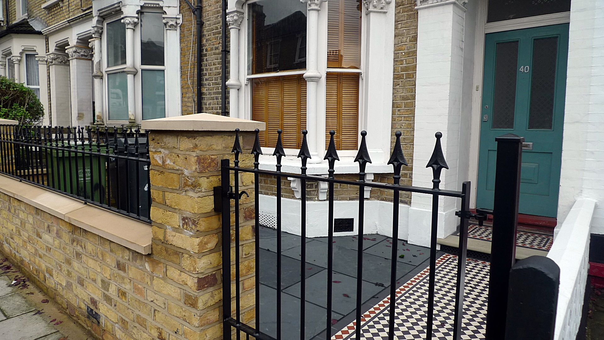 Ornamental stone Victorian mosaic multi colour mosaic yellow brick metal gate metal rail York stone entrance stone  London stock  brick garden wall Earsfield Wimbledon Wandsworth Putney London