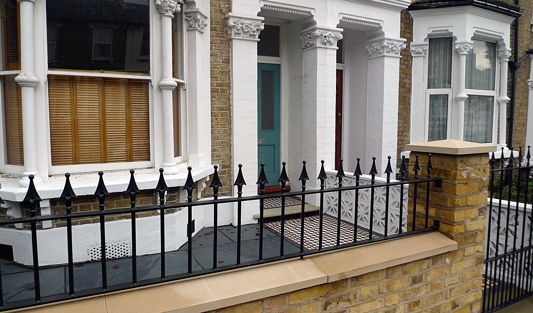 Ornamental stone Victorian mosaic multi colour mosaic yellow brick render garden wall metal rail metal gate York stone entrance stone Earlsfield Wimbledon Wandsworth Putney London