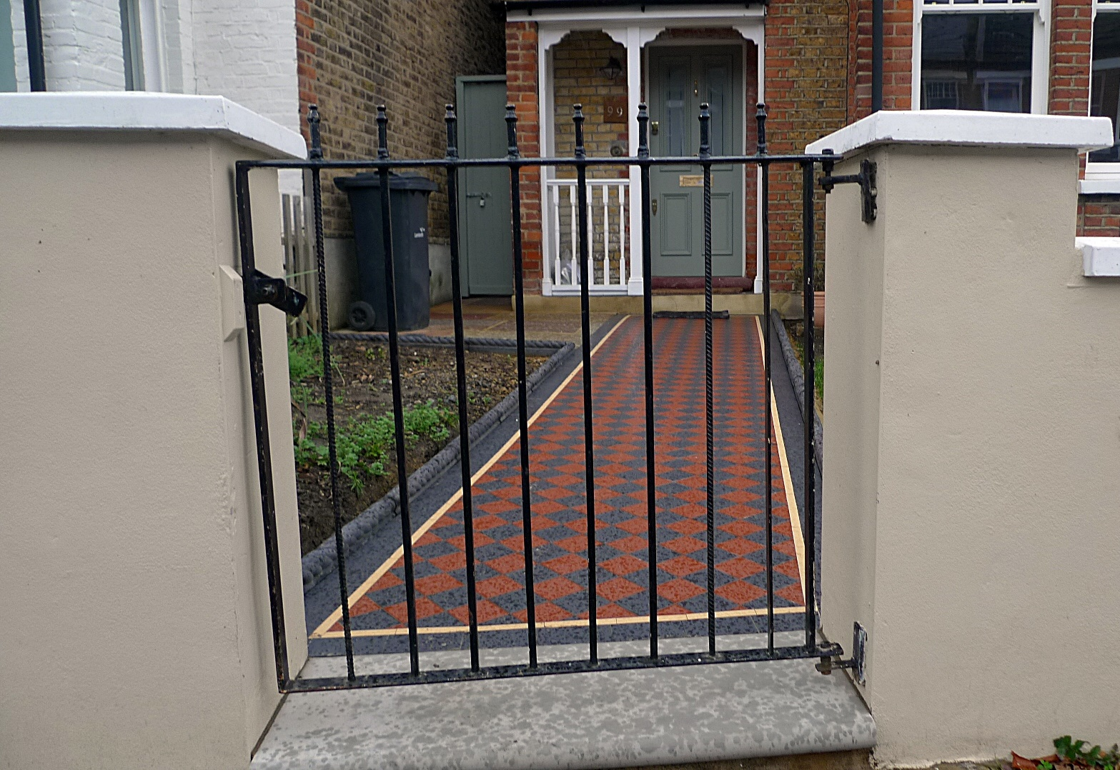 Ornamental stone multi colour mosaic Victorian mosaic metal gate metal rail York stone entrance stone charcoal rope edge tiles render garden wall Streatham Clapham West Norwood Balham London