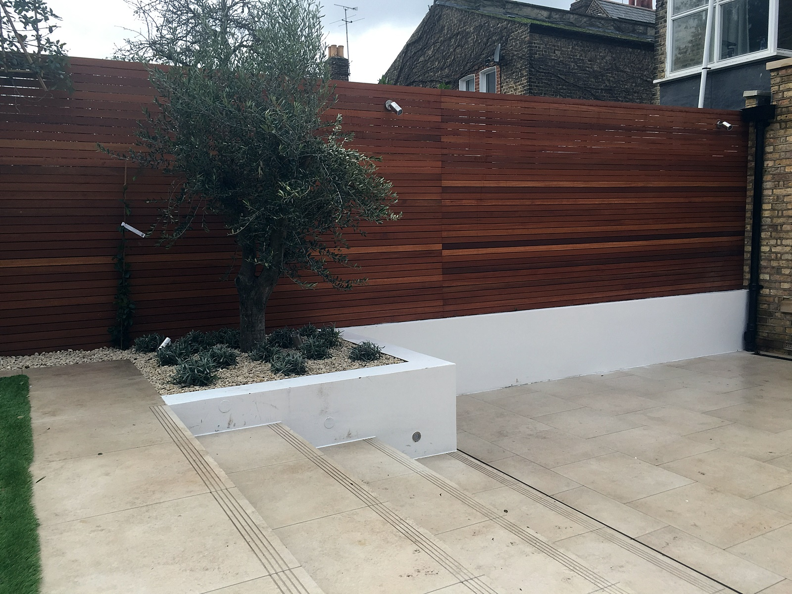 Travertine path London design wood garden wall trellis Clapham Wandsworth Putney