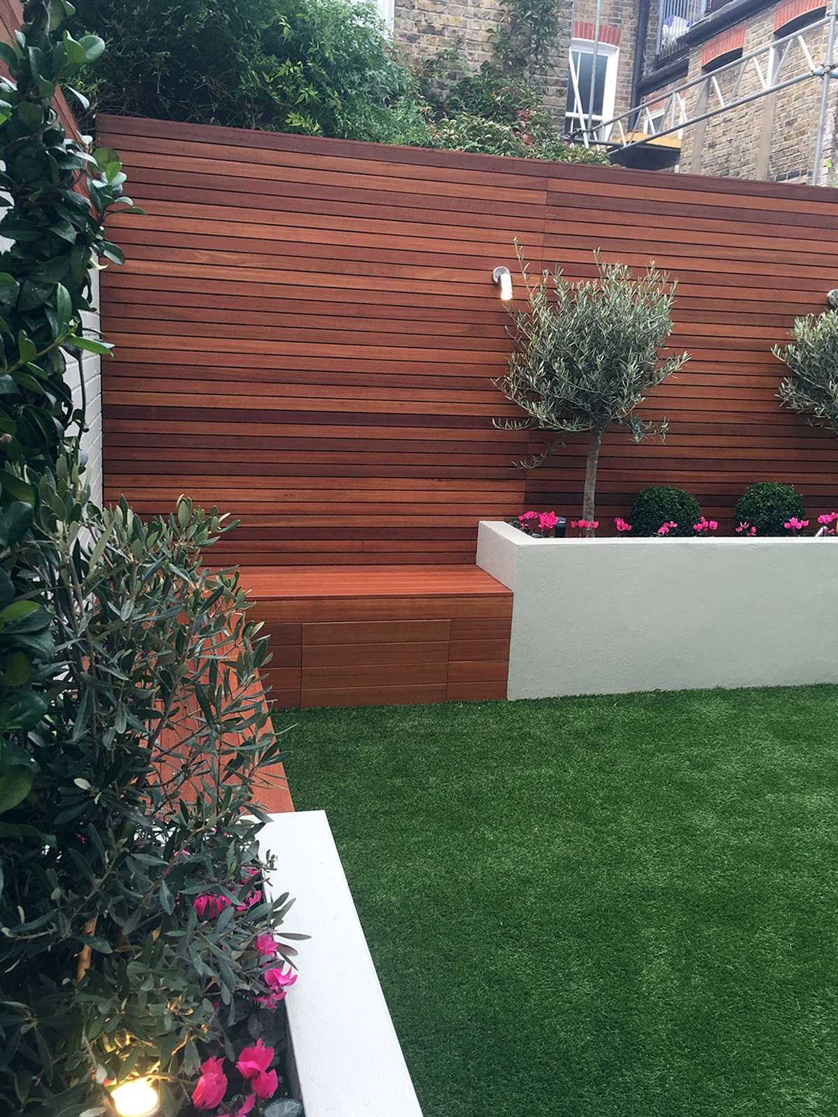 artificial grass mayfair render block walls painted french grey hardwood cedar screen floating storage bench clapham fulahm chelsea london