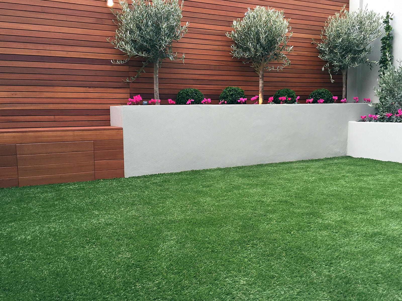 artificial grass raised beds hardwood screen privacy trellis fence storage bench modern design garden battersea fulham chelsea mayfair london
