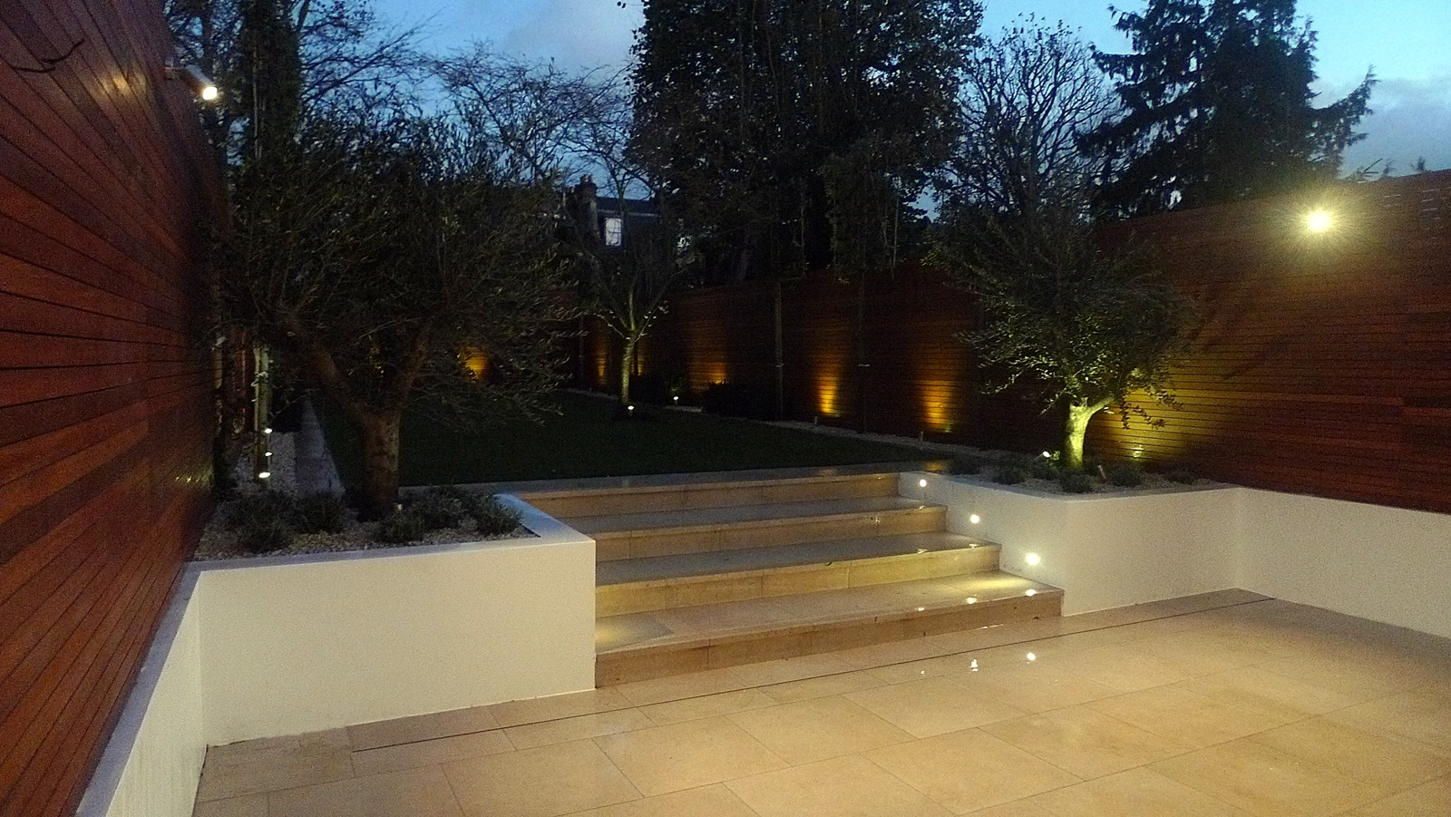 cream tiles pleached trees artificial grass garden lighting hardwood garden privacy screen trellis horizontal screen wandsworth clapham fulham chelsea kensington balham london