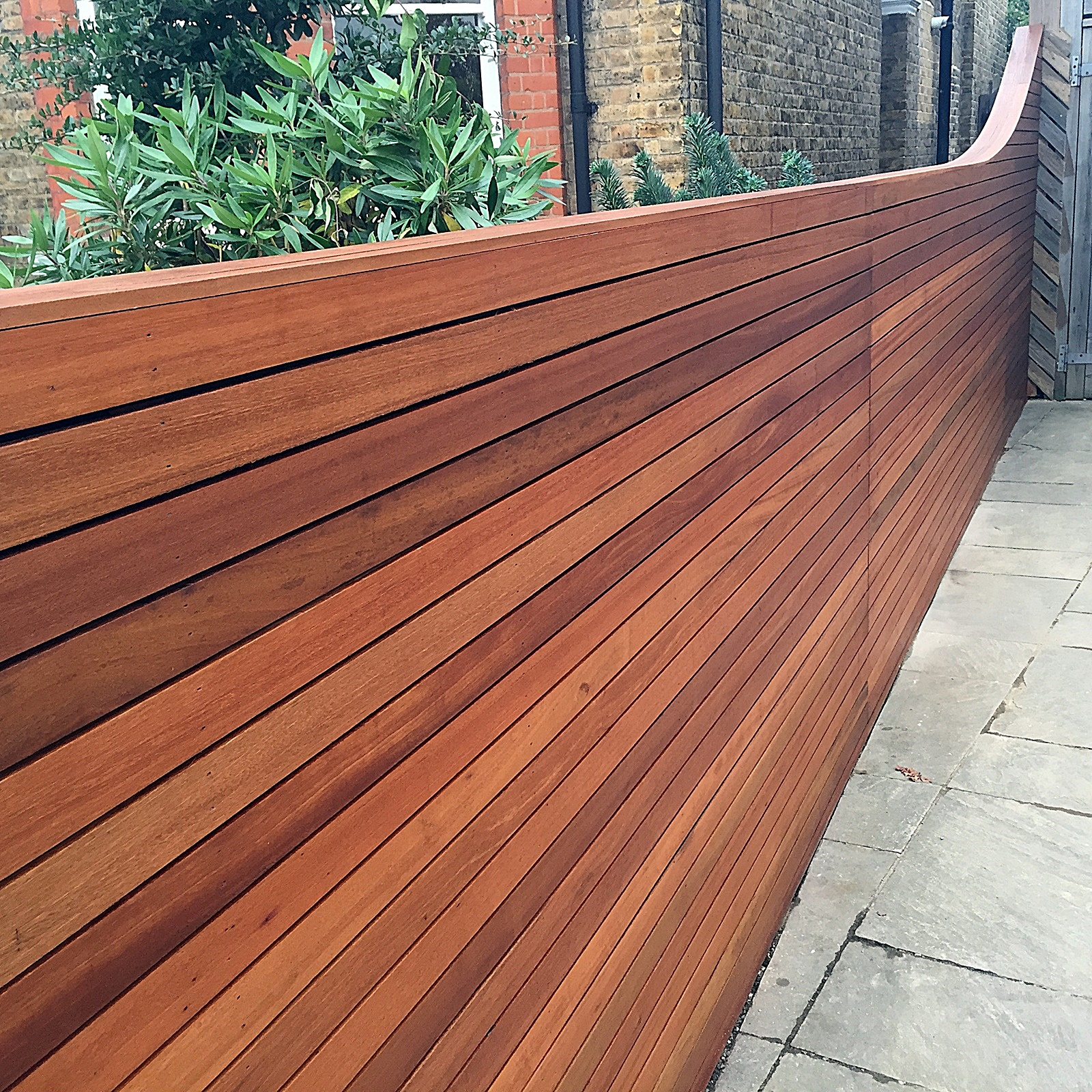 Horizontal cedar hardwood strip wood trellis screen fence for Wood screen fence