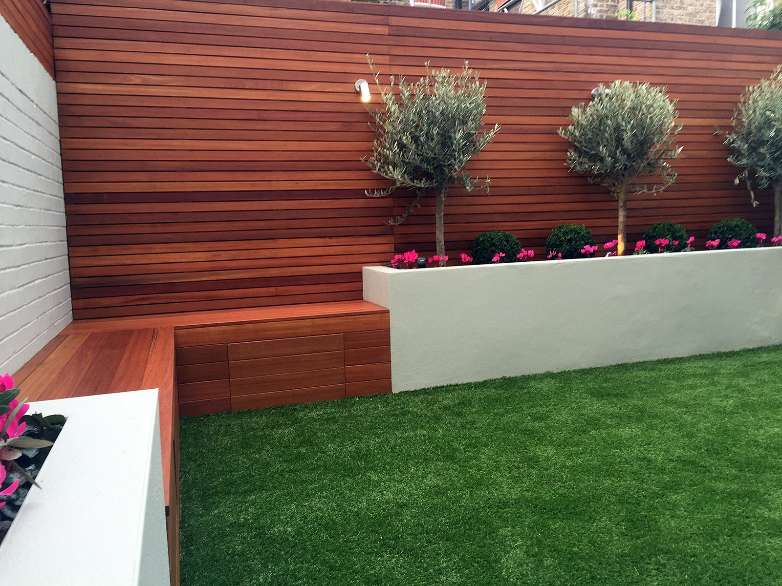 raised beds hardwood bench low maintenance modern garden design courtyard builder olive trees cyclamen lighting irrigation artificial grass battersea balham clapham dulwich london